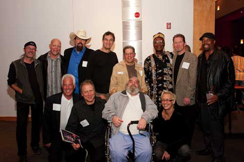 Attendees gather around John Bergamo at the Founders Ball last Saturday night at REDCAT.