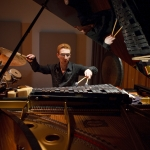 Faculty member Danny Holt plays piano and percussion simultaneously at the Roy O. Disney Concert Hall in 2009.
