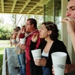 Powell (in red) teaches a circular breathing exercise to CalArts students | Photo: Steve Gunther