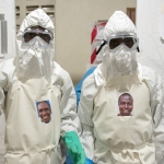 Health care workers Emmanuel Nagbe (left) and Gideon Gearue are dressed to take dinner into the Ebola treatment unit in Monrovia, Liberia. | Photo: Marc Campos, Occidental College Photographer