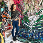 Artist Alicia Piller surrounded by her exhibition works